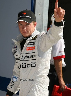 Pole winner Kimi Raikkonen celebrates