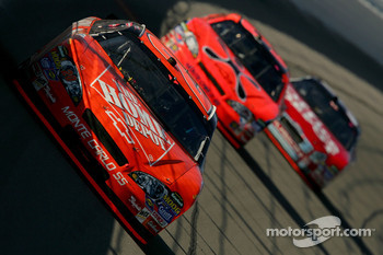 Tony Stewart leads Jeff Burton and Carl Edwards