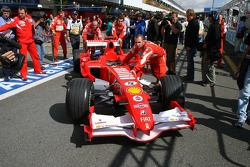 Michael Schumacher's Ferrari i pushed from the garage to scrutineering