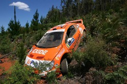 The OMV Peugeot Norway Peugeot 307 WRC of Henning Solberg and Cato Menkerud after a crash