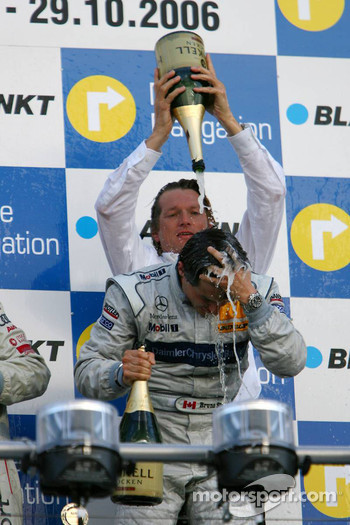 Podium: Bruno Spengler gets a champagne shower from Hans-Jürgen Mattheis