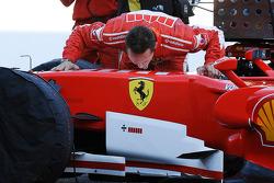 Michael Schumacher kisses his car