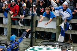 Petter Solberg throws his gloves to the fans