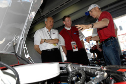 Alan Mulally, President and CEO Ford Motor Company is shown the Ford Fusion race car by Mark Martin