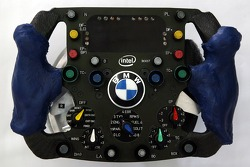 Special Parts for Alex Zanardi driving F1, like the steering wheel with clutch and accelerator, the changed break pedal and a metal-plate to fix left foot of Alex Zanardi