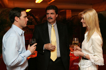 2006 NASCAR NEXTEL Cup Series champion Jimmie Johnson, NASCAR President Mike Helton and Chandra Johnson talk prior to the champion's welcome dinner at the Waldorf-Astoria Hotel