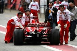 Kimi Raikkonen stops in the pitlane