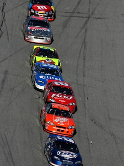Kurt Busch leads the field on a restart