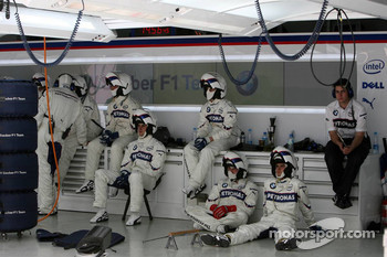 BMW Sauber F1 Team mechanics rest whilst simulating a race