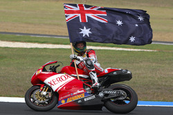 Troy Bayliss celebrates his win over James Toseland