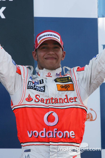 Podium: third place Lewis Hamilton celebrates