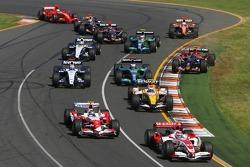 Takuma Sato, Super Aguri F1, SA07 and Jarno Trulli, Toyota Racing, TF107