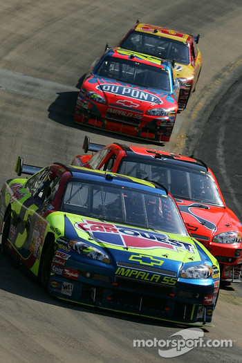 Kyle Busch leads Jeff Burton in the last lap