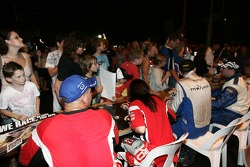 ARC Rally drivers signing autographs