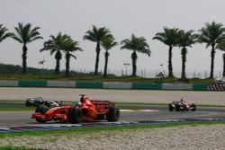 Kimi Raikkonen, Scuderia Ferrari, F2007 and Ralf Schumacher, Toyota Racing, TF107