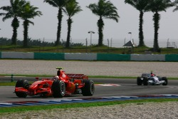 Kimi Raikkonen, Scuderia Ferrari, F2007 and Robert Kubica, BMW Sauber F1 Team, F1.07