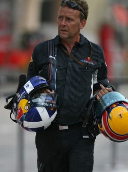 Red Bull Racing, team personnel carrying drivers helmets