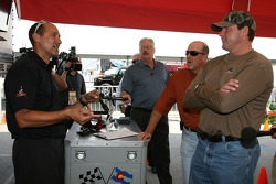 Go-kart owner Jim Keesling gives a few tips to Roger Clemens