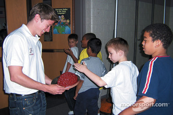 Ian Baas and a student at the school appearance for Think First