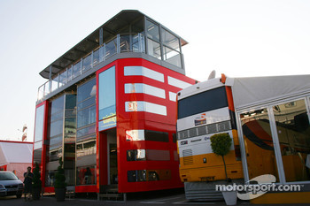 The new Ferrari motorhome which is now 3 stories high which towers over one of the Renault motorhomes