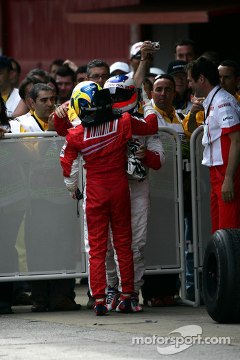 Race winner Felipe Massa celebrates with Rubens Barrichello