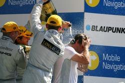 Podium: Bruno Spengler, Team HWA AMG Mercedes, Mika Hakkinen, Team HWA AMG Mercedes, and Paul di Resta, Persson Motorsport AMG Mercedes, give Gerhard Ungar, Chief Designer AMG a champagne shower
