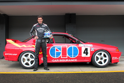 Rick Kelly standing in front of the R32 Skyline