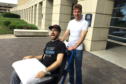 James Hinchcliffe is wheeled from the hospital by Will Power