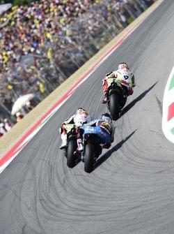 Danilo Petrucci and Yonny Hernandez, Pramac Racing Ducatis and Scott Redding, Marc VDS Racing Honda