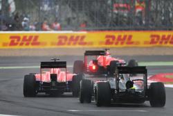 Will Stevens, Manor F1 Team and Roberto Merhi, Manor F1 Team lead Fernando Alonso, McLaren MP4-30