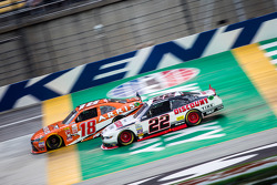 Daniel Suarez, Joe Gibbs Racing Toyota and Brad Keselowski, Team Penske Ford