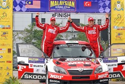 Winner: Pontus Tidemand and Emil Axelsson, Skoda Fabia S2000, Team MRF celebrate their victory in the Malaysian Rally
