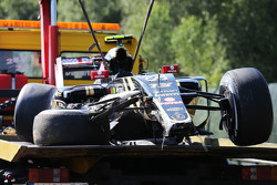 The damaged Lotus F1 E23 of Pastor Maldonado, Lotus F1 Team, who crashed in the first practice session