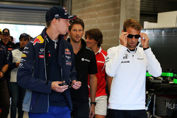 (L to R: Daniil Kvyat, Red Bull Racing with Jenson Button, McLaren