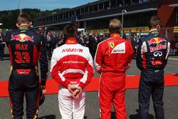 (L to R): Max Verstappen, Scuderia Toro Rosso; Will Stevens, Manor F1 Team; Kimi Raikkonen, Ferrari; and Daniil Kvyat, Red Bull Racing as the grid observes the national anthem