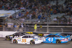 Cole Whitt, Front Row Motorsports Ford and Aric Almirola, Richard Petty Motorsports Ford