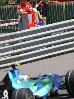 Michael Schumacher watches the session from