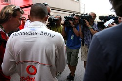 Camera crews film, Lewis Hamilton, McLaren Mercedes
