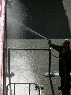 A team member washes a transporter