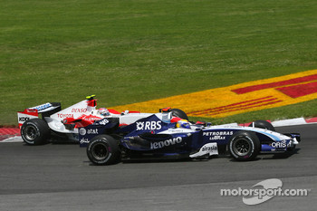 Nico Rosberg, WilliamsF1 Team, FW29 and Jarno Trulli, Toyota Racing, TF107