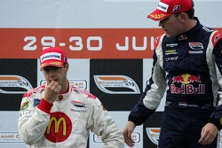 Podium: race winner Robert Doornbos offers to shake hands with Sébastien Bourdais