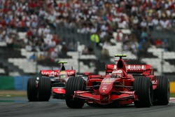 Kimi Raikkonen, Scuderia Ferrari, F2007 and Lewis Hamilton, McLaren Mercedes, MP4-22