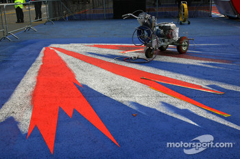 The Silverstone logo is painted onto the floor of the paddock