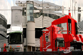 Scuderia Ferrari reflection in the McLaren Mercedes Motorhome