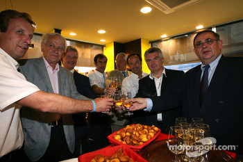 Marco Werner, Frank Biela and Emanuele Pirro at a fine food store inauguration after the traditional winners manhole cover ceremony in downtown Le Mans