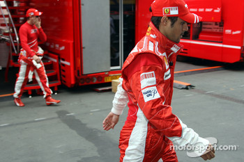 Felipe Massa, Scuderia Ferrari and Kimi Raikkonen, Scuderia Ferrari in the back on different ways in the garage