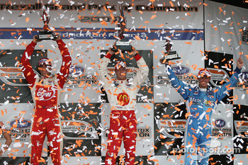 Podium: race winner Sébastien Bourdais with Justin Wilson and Graham Rahal