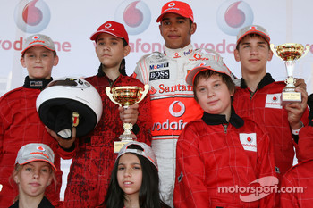 Lewis Hamilton, McLaren Mercedes, with young karters at the Vodafone karting event