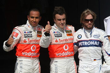 Pole winner Fernando Alonso, second, Lewis Hamilton, third, Nick Heidfeld