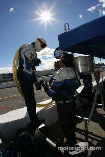 TRG team members wait for a pitstop